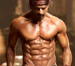Master-buster Shahrukh Khan flaunting his eight pack abs in Happy New Year